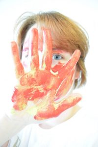 Self-portrait with high exposure - smeared with paint